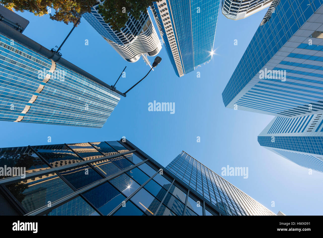 Modern skyscrapers and blue sky - Stock Image