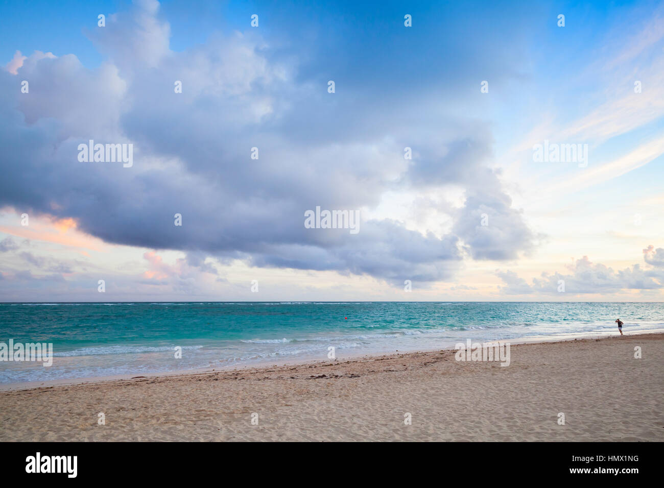 Atlantic ocean coast. Landscape with dramatic cloudy sky in sunrise, Dominican republic. Punta Cana. Bavaro beach - Stock Image