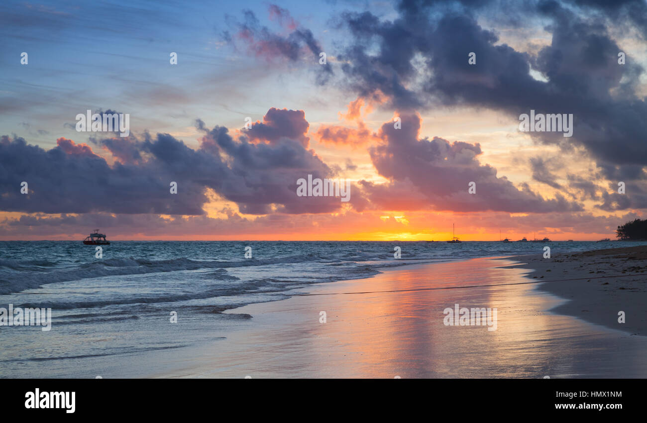 Colorful sunrise over Atlantic Ocean coast, Bavaro beach, Hispaniola Island. Dominican Republic, coastal landscape - Stock Image