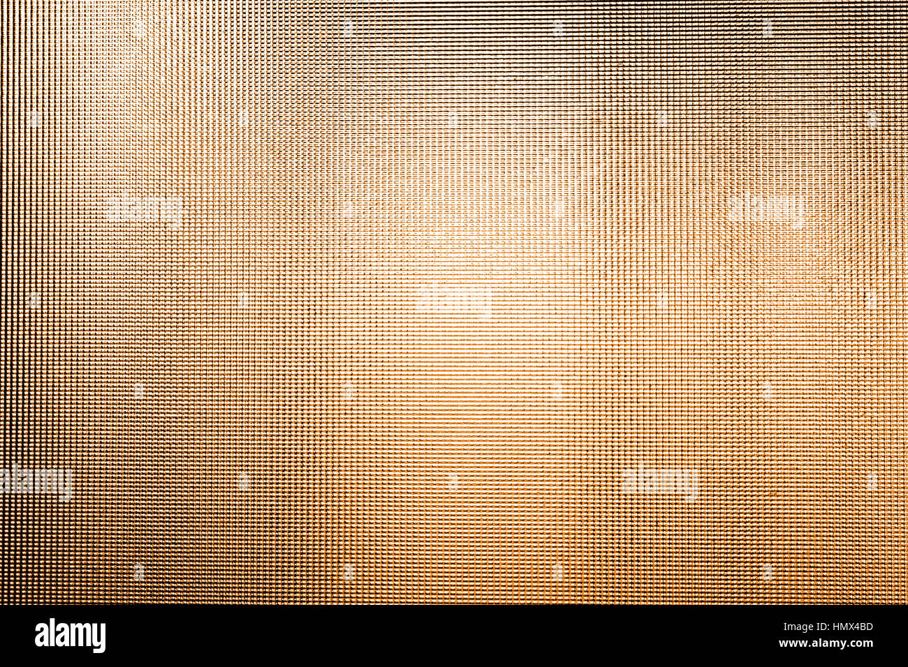 Dotted textured transparent glass copper orange color Stock Photo