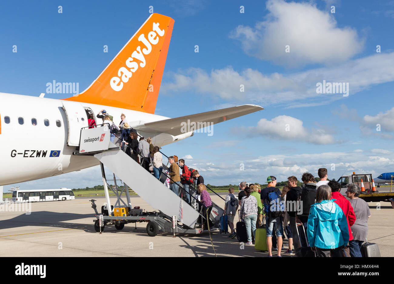 BRISTOL, UK - JULY 11, 2016: A queue of passengers boarding the tail end of an Easyjet aircraft at Bristol Airport Stock Photo