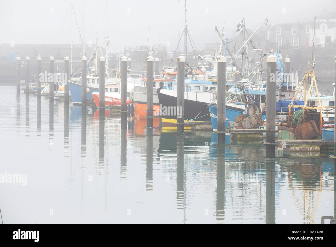 Mixed fishing and pleasure boats on a misty morning in Newlyn Harbour, Cornwall, England, UK. Stock Photo