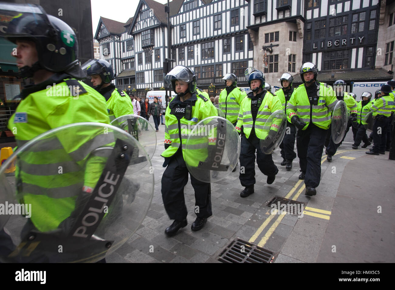 Metropolitan Riot Police on the streets of London during a students ant-cuts demonstration, Central London, England, - Stock Image