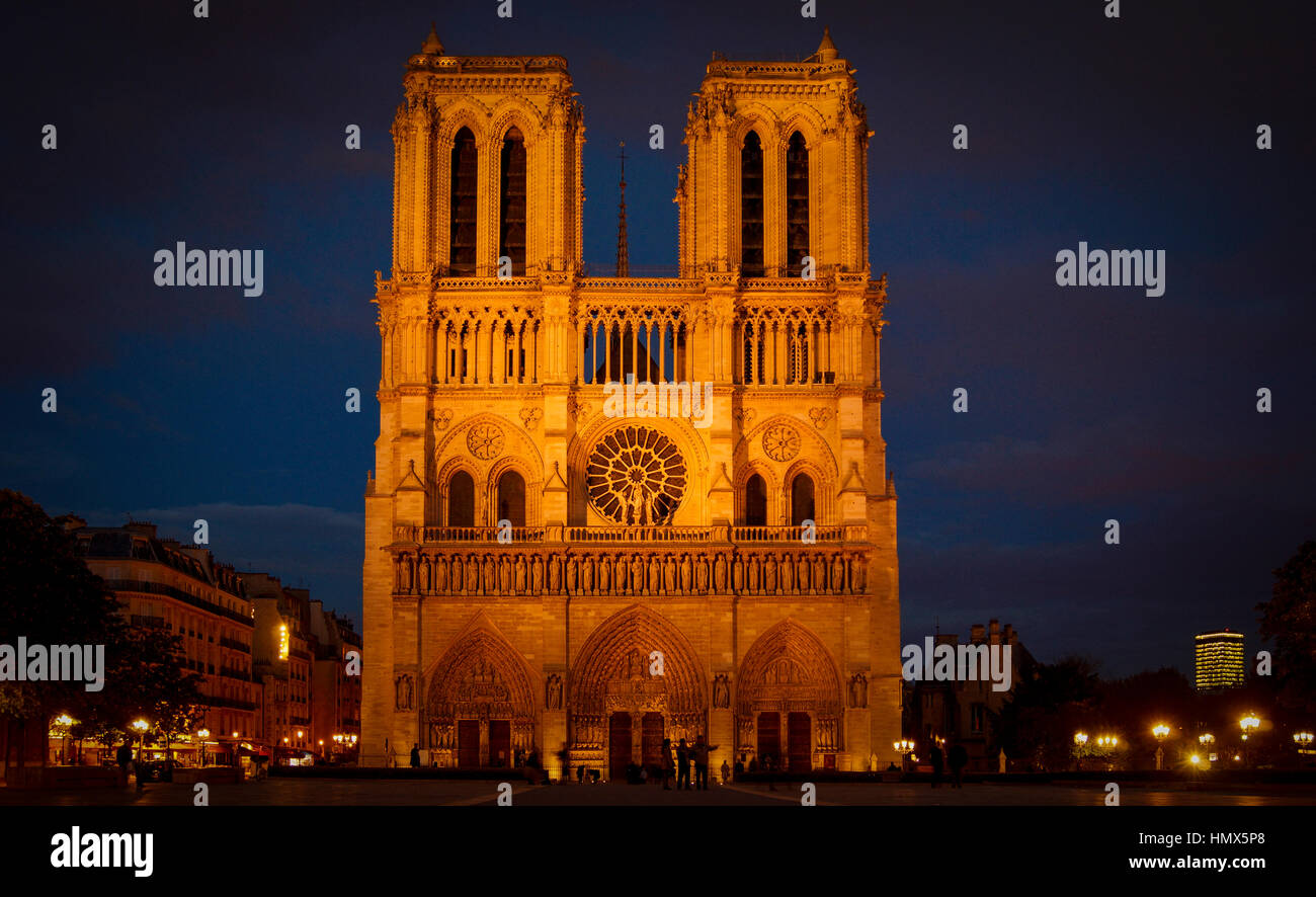 Tourists visiting the Cathedrale Notre Dame de Paris is a most famous cathedral (1163 - 1345) on the eastern half - Stock Image