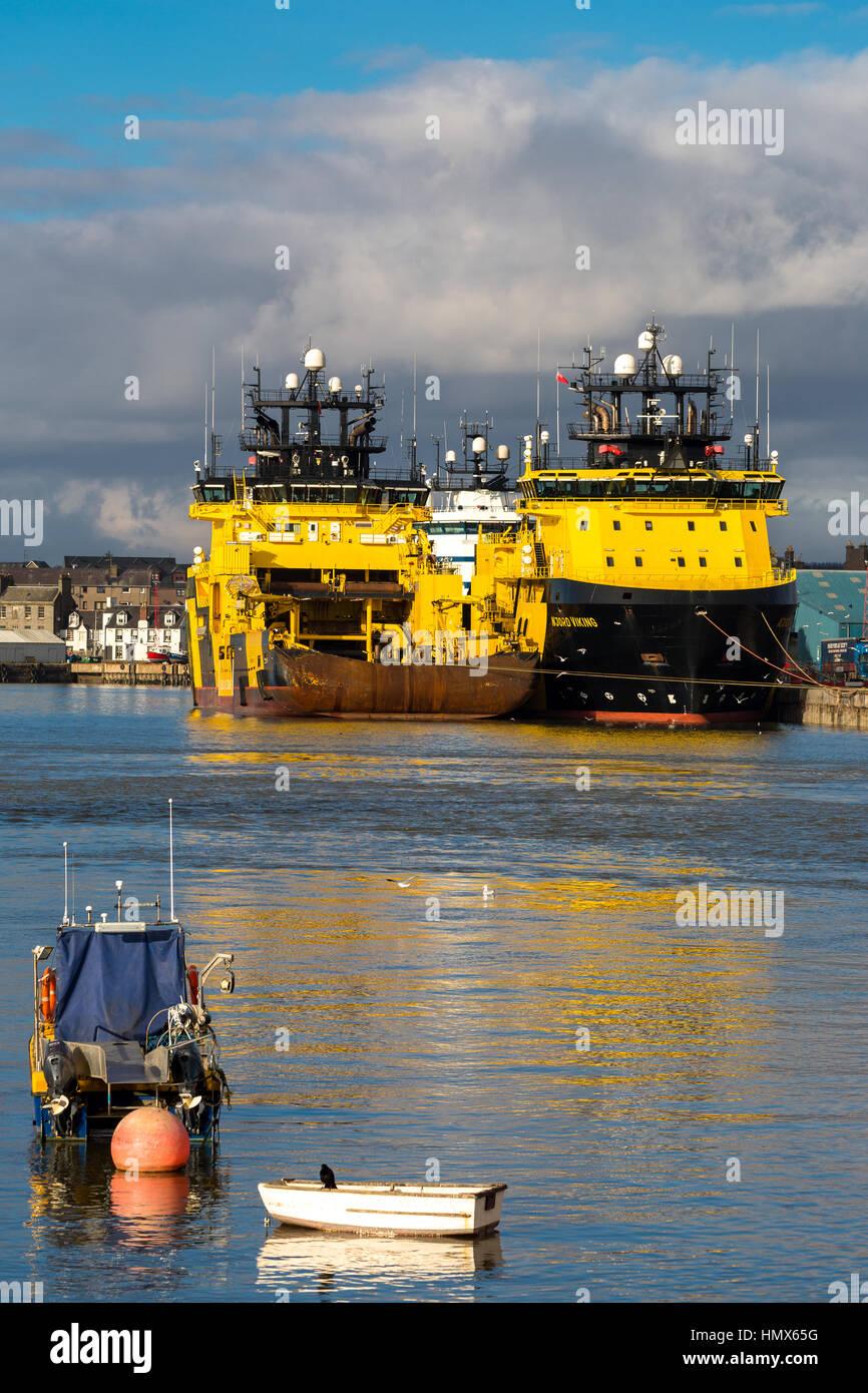 Viking  yellow oil industry supply ships berthed Montrose Scotland UK - Stock Image