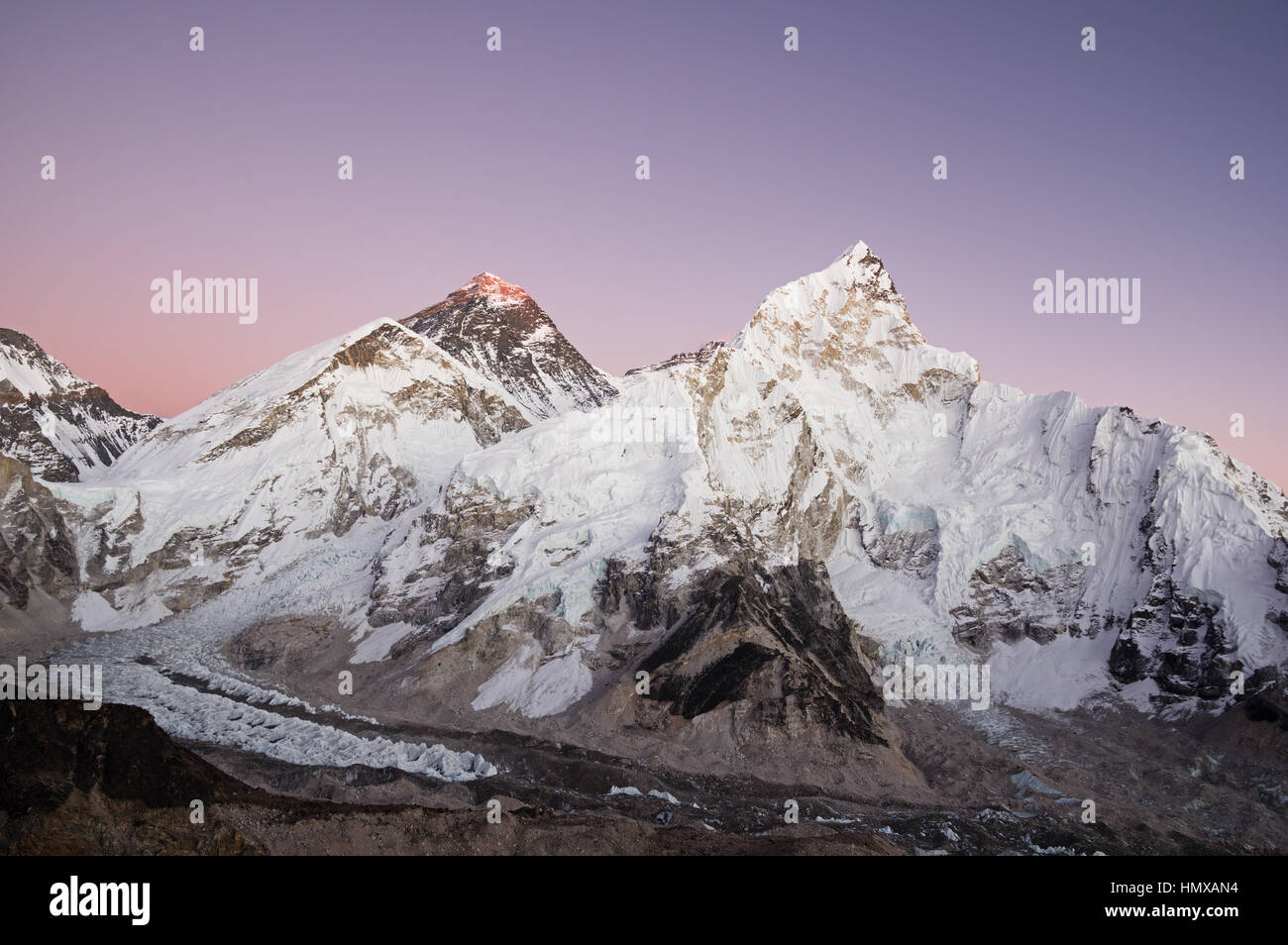Mount Everest and Nuptse seen from Kala Patthar just after sunset with purple sky - Stock Image