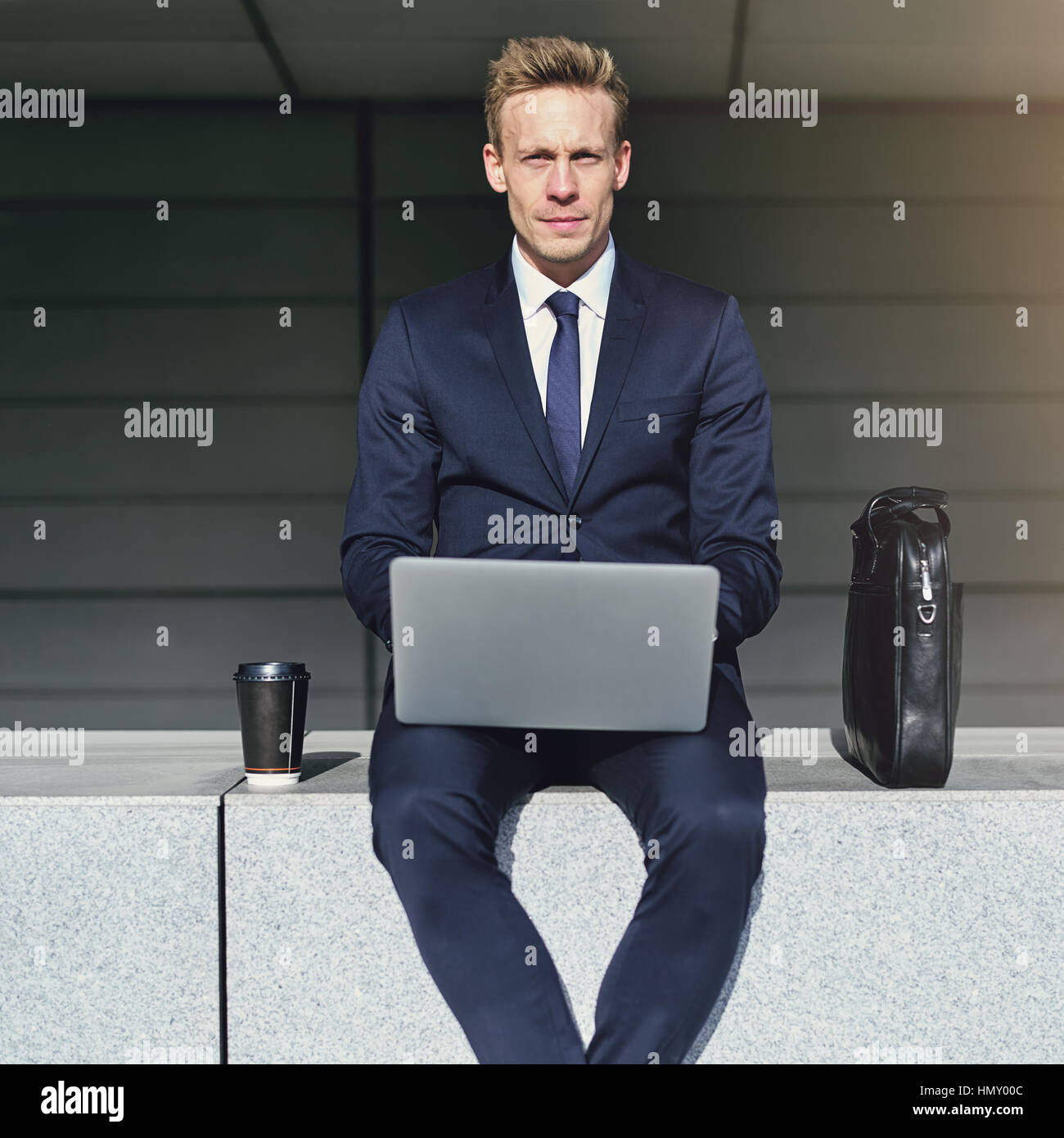 Looking at camera stylish businessman. Horizontal outdoors shot - Stock Image