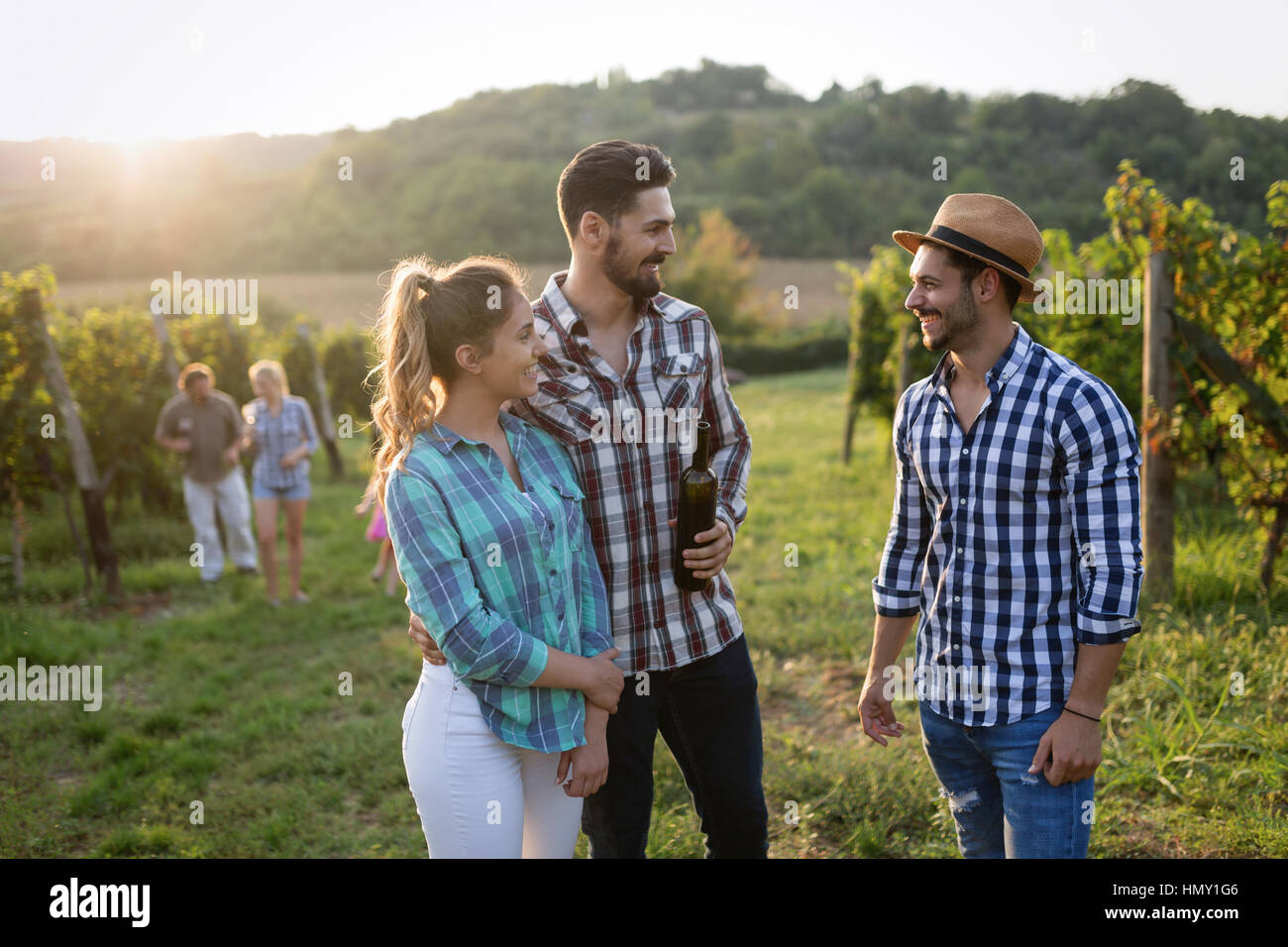 Wine grower and people in winery vineyard - Stock Image