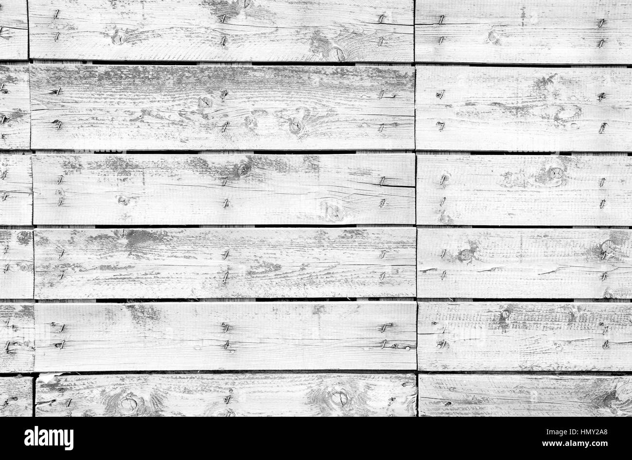 Old wooden planks texture with weathered white paint - Stock Image