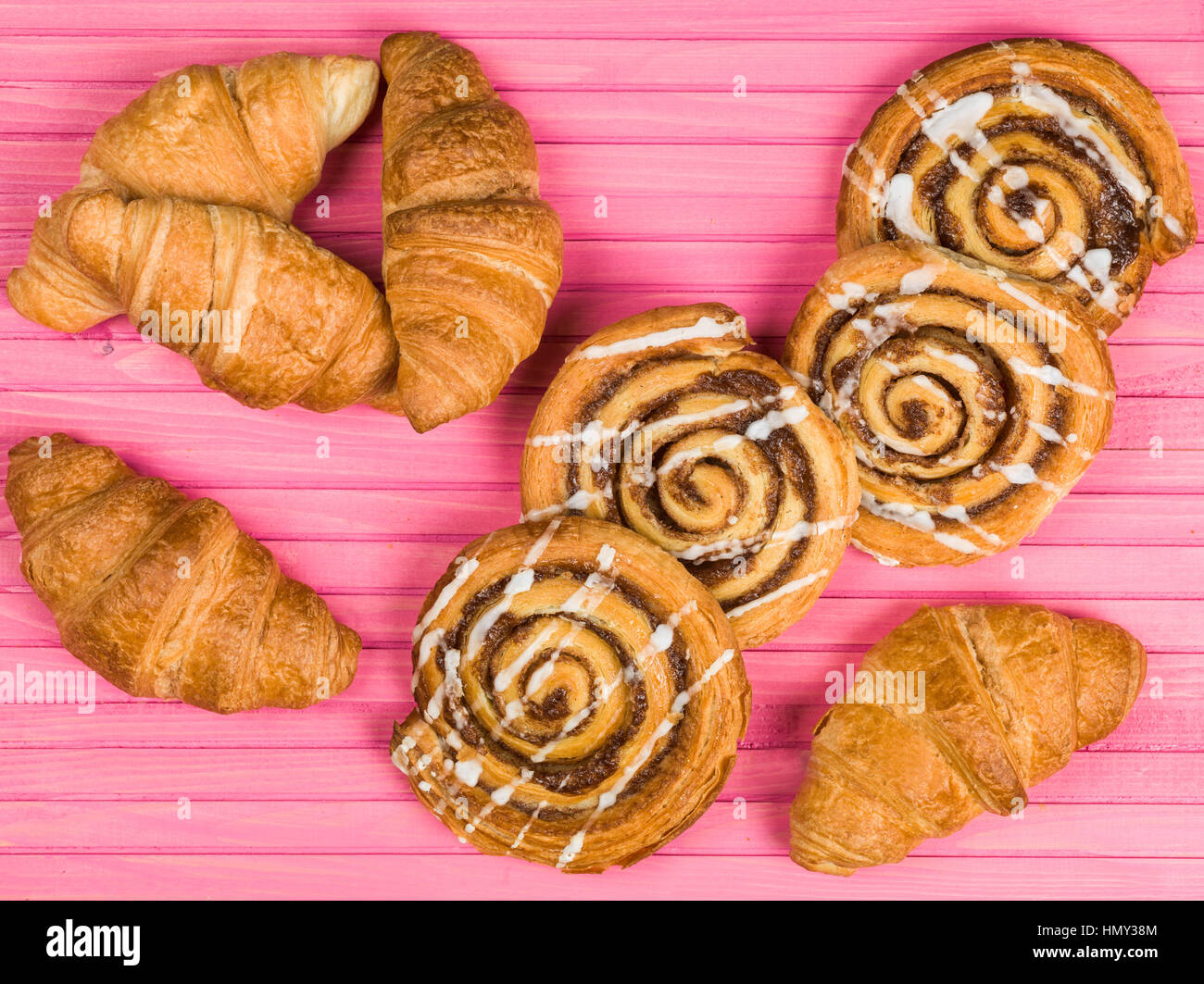 Selection of Croissants and Cinnamon Swirls Breakfast Pastries - Stock Image