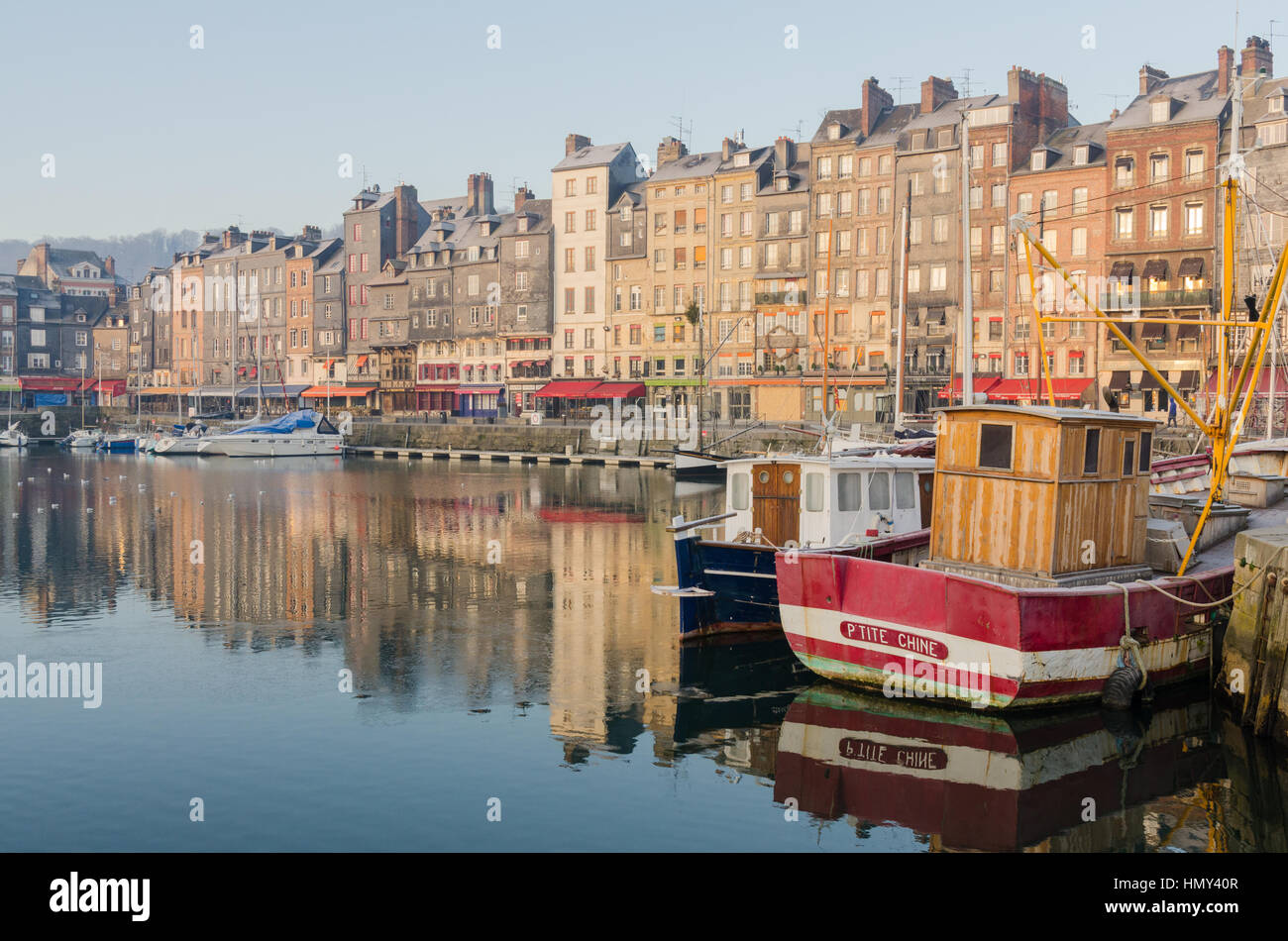 Tall narrow houses in the Vieux Bassin in the port of Honfleur, Normandy Stock Photo