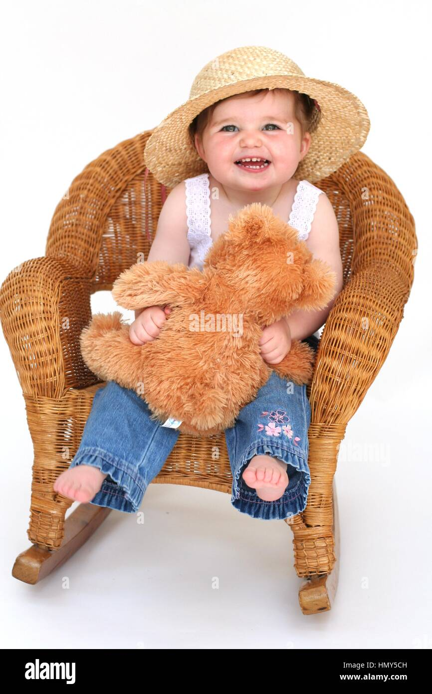 2328df3fff3 Little toddler child photoshoot sitting in a wicker chair with cuddly teddy  bear happy baby girl hat teddy bear love sweet cute beautiful joy laughing