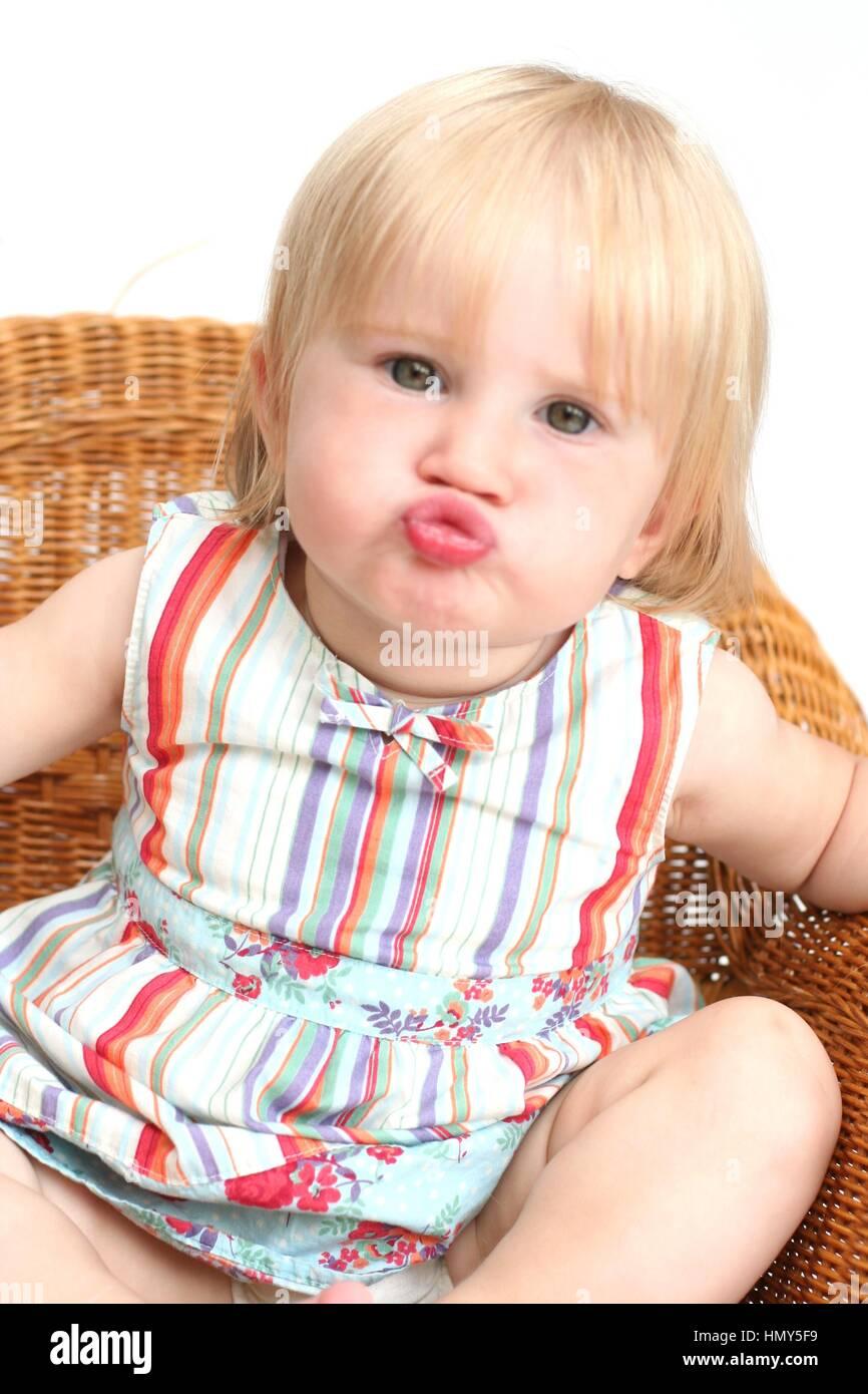 little girl child blonde baby girl todder sitting in a wicker