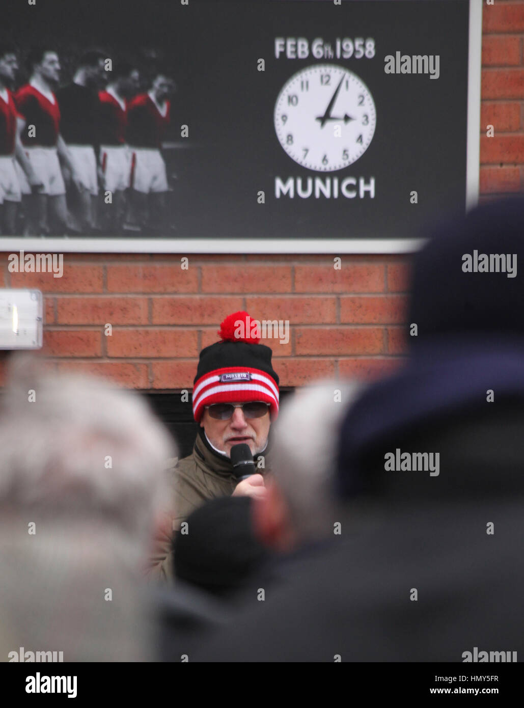 Manchester United supporters outside the football club on the 59th anniversary of the Munich Air Disaster, 6/2/17. - Stock Image