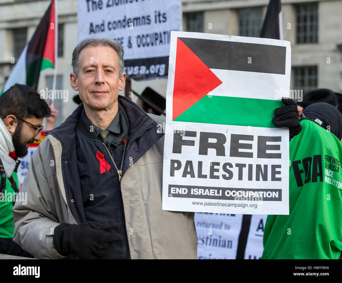 London, UK. 6th Feb, 2017. Human rights campaigner Peter Tatchell holds a Free Palestine placard outside Downing - Stock Image