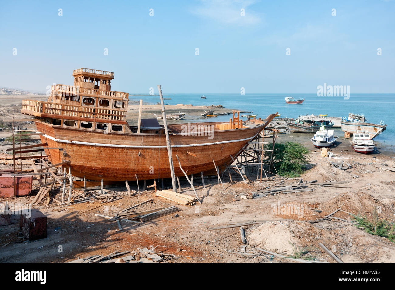 Traditional wooden cargo vessel at shipyard on Qeshm Island, Persian Gulf, Iran - Stock Image
