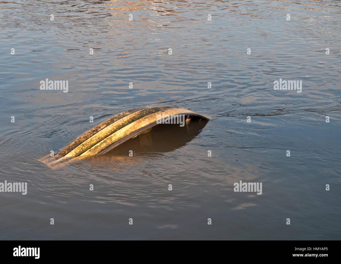 Sunken rowing boat after heavy rain on the river wear., - Stock Image