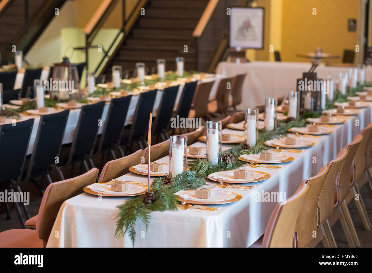 Wedding Reception Tables With Seating Plates And Candles At A