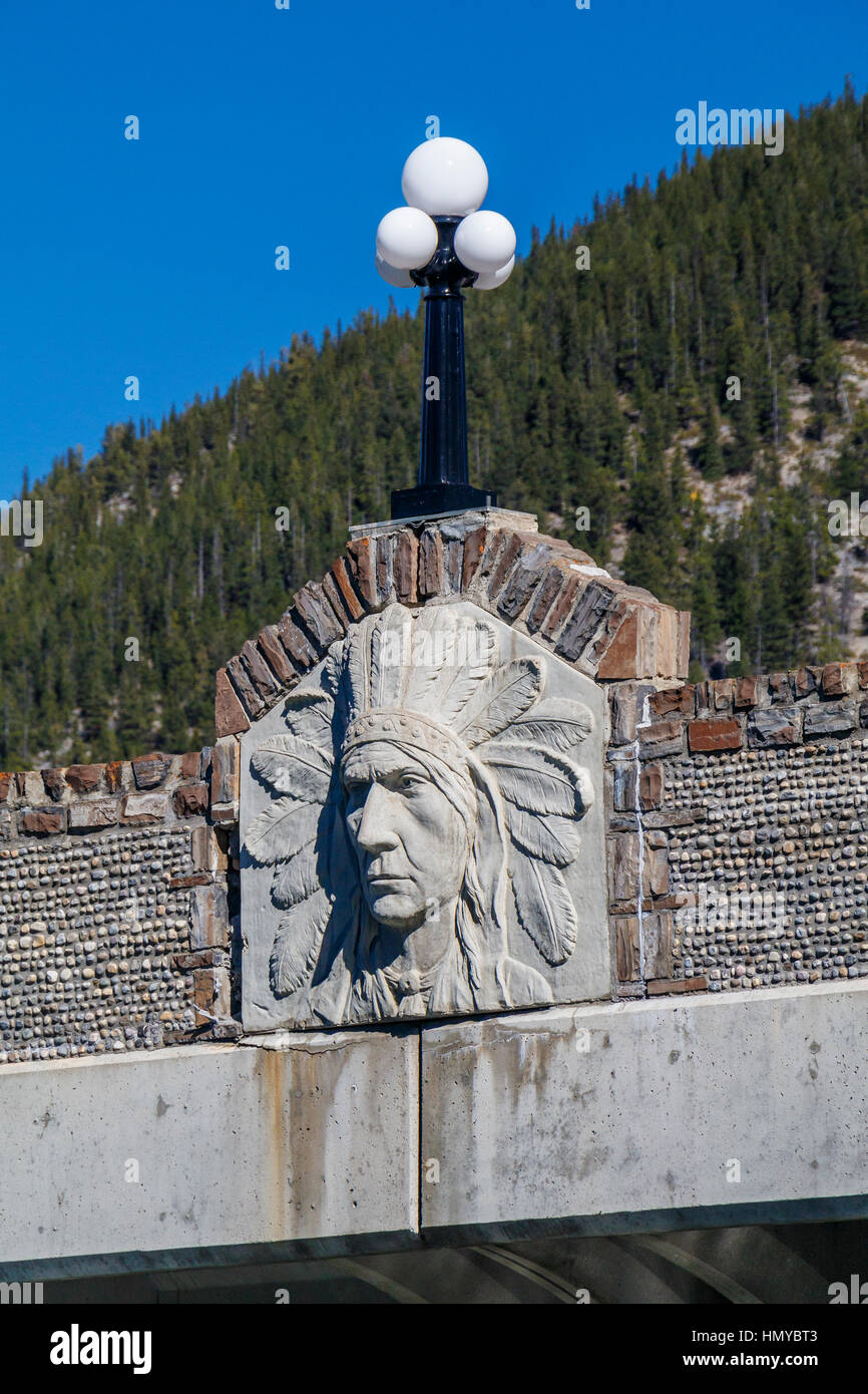 Detail of the First Nation relief on the 1921 Bow River bridge in Banff National Park, Alberta, Canada. Bridge designed - Stock Image