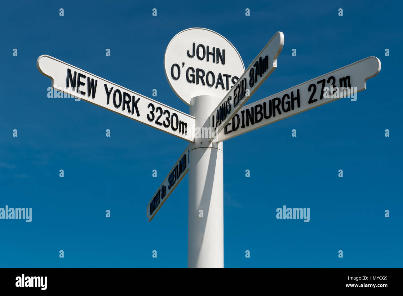 The milepost sign at John O Groats near Caithness in Scotland on the most north eastern tip of the UK. - Stock Image