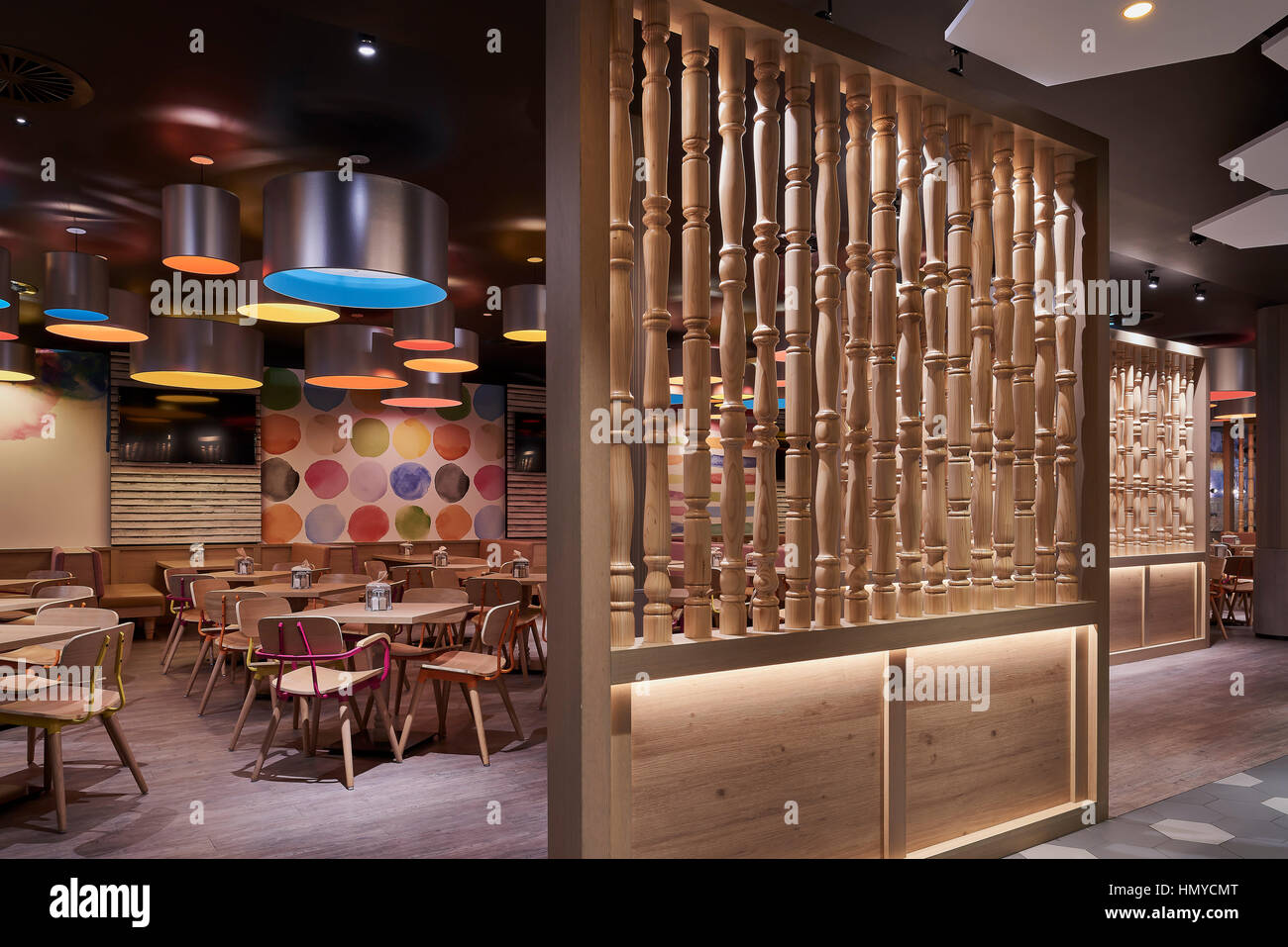View into separate restaurant area with timber screens and coloured view into separate restaurant area with timber screens and coloured feature lighting and painted wall campbelltown catholic club sydney australia aloadofball Choice Image