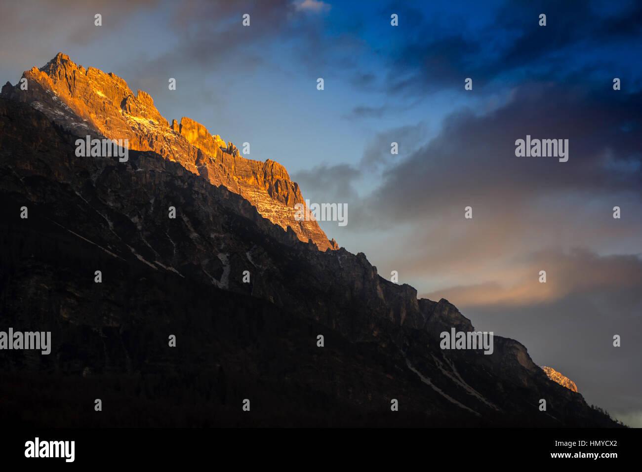 Sunset in Dolomites, mountains around Famous ski resort Cortina D Ampezzo - Stock Image