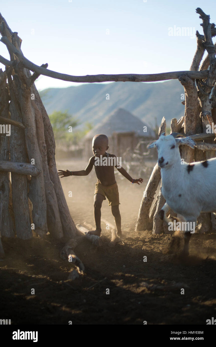Himba boy working in a kraal - Stock Image
