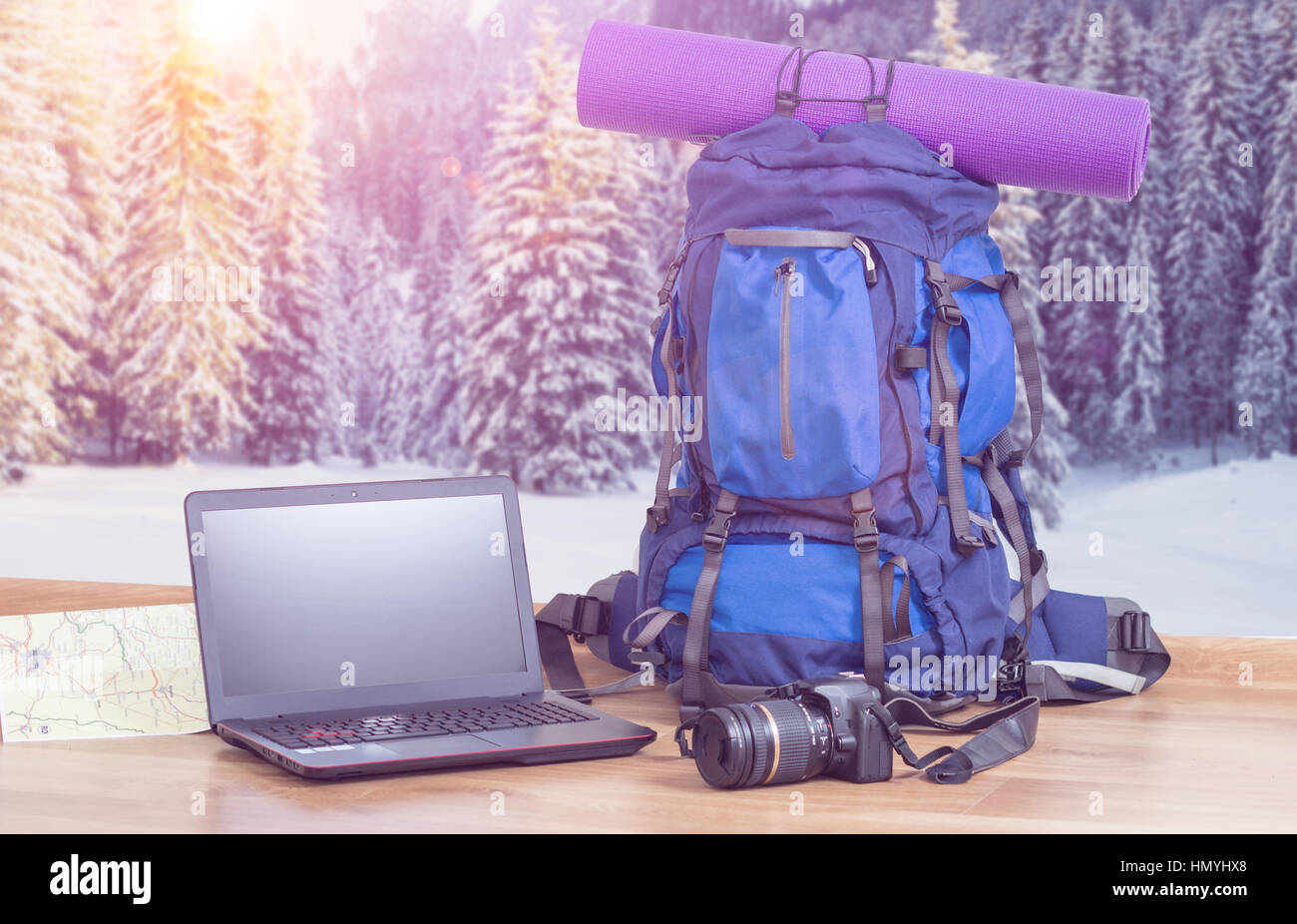 backpack laptop and camera with winter background - Stock Image
