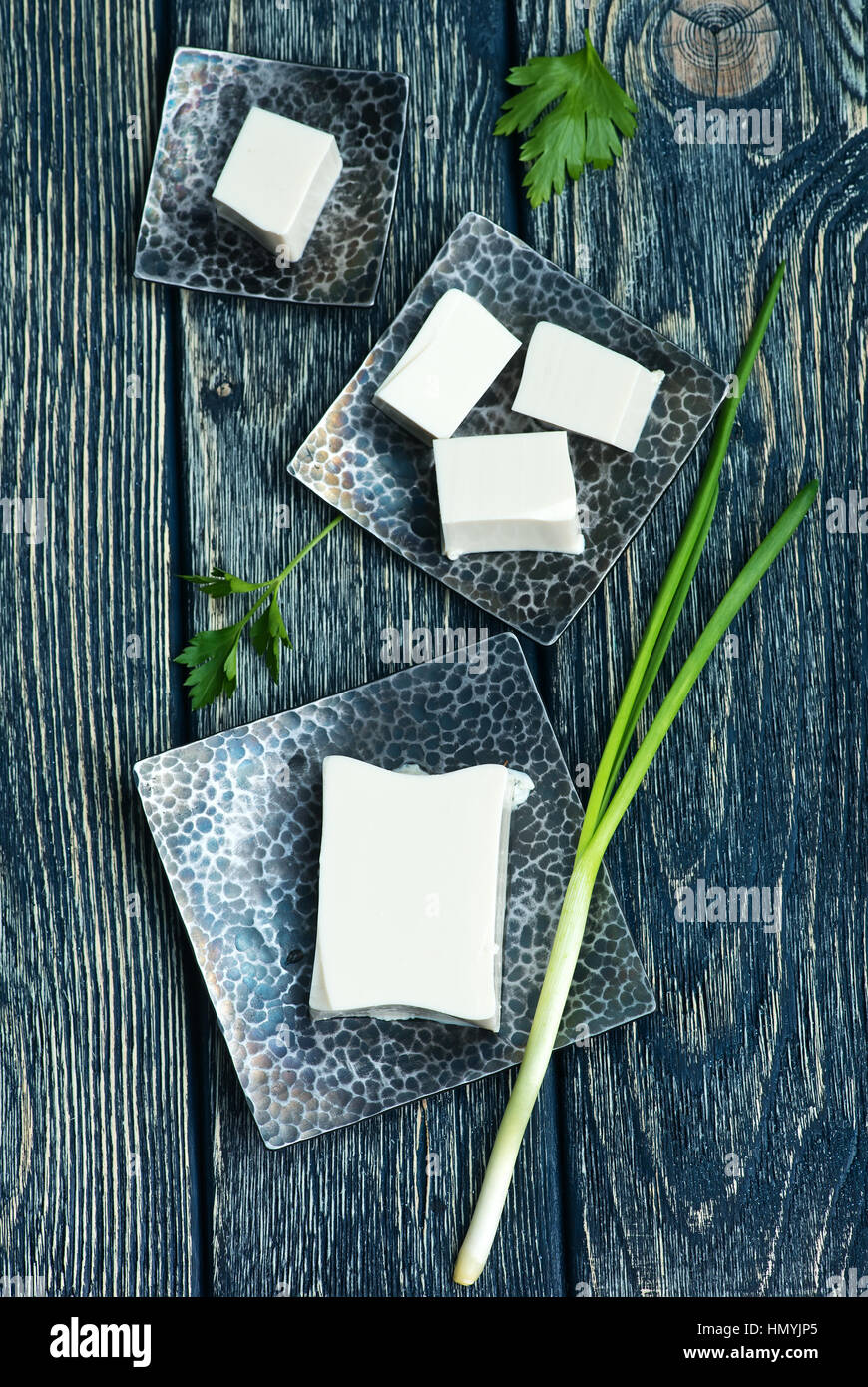 tofu cheese on plate and on a table - Stock Image