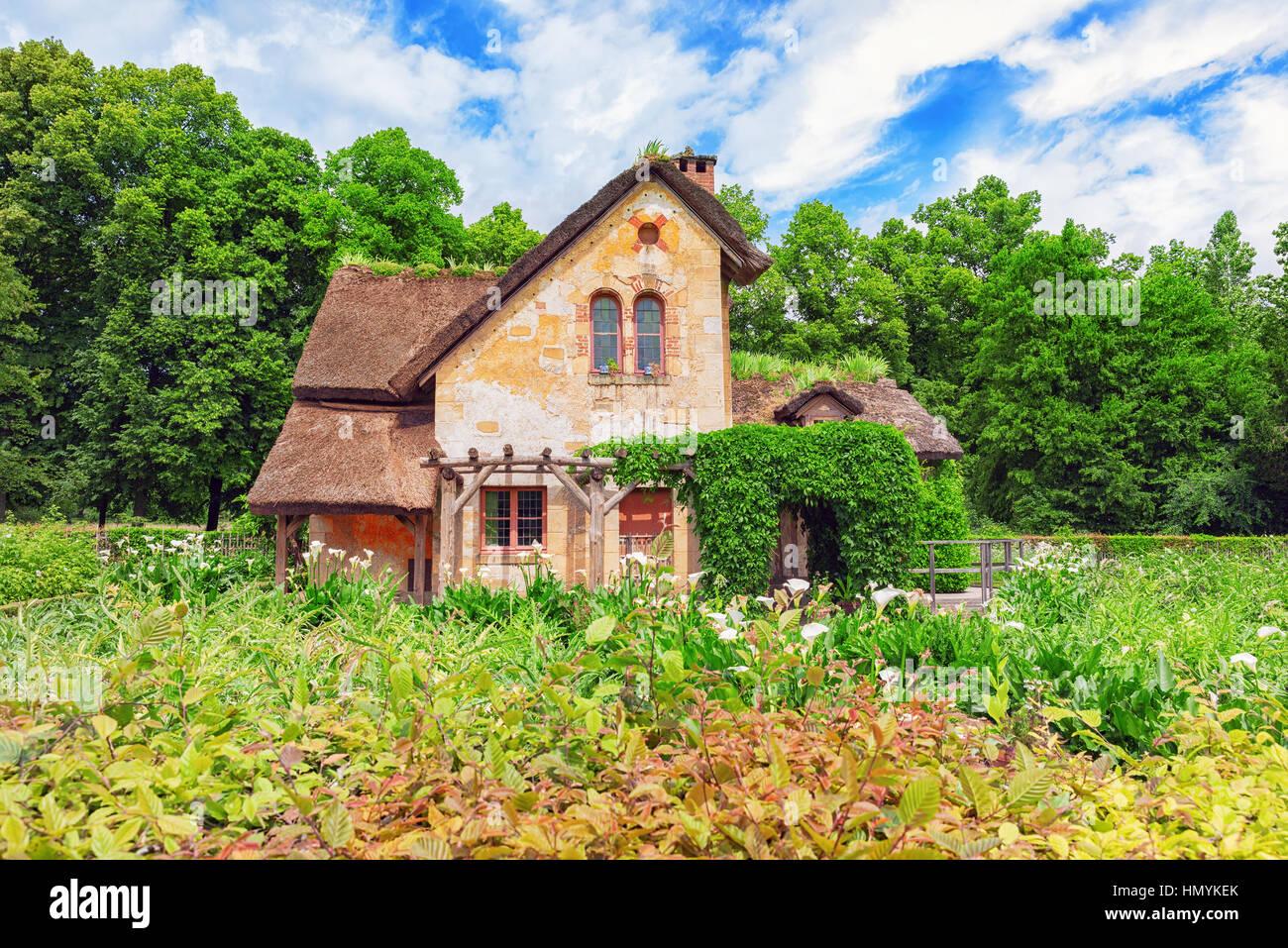 VERSAILLES, FRANCE - JULY 02, 2016 : Landscape of hamlet Queen Marie Antoinette's estate near Versailles Palace. - Stock Image