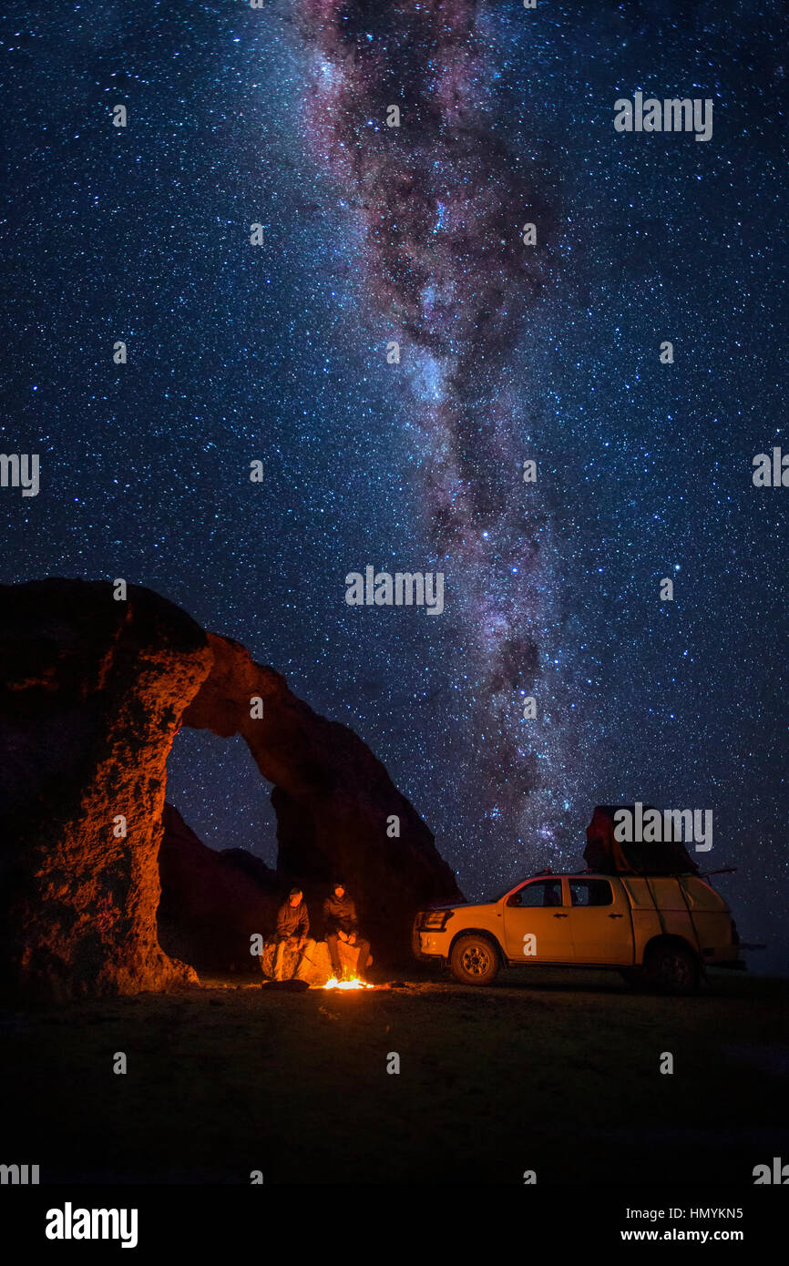 Camping under a rock arch - Stock Image