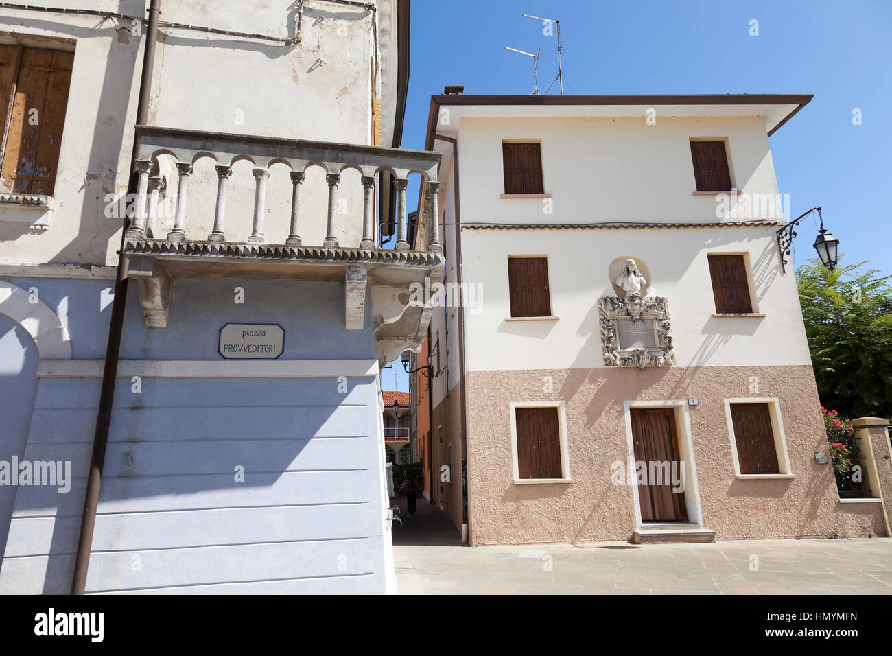 Square with ancient well, Marano Lagunare Stock Photo