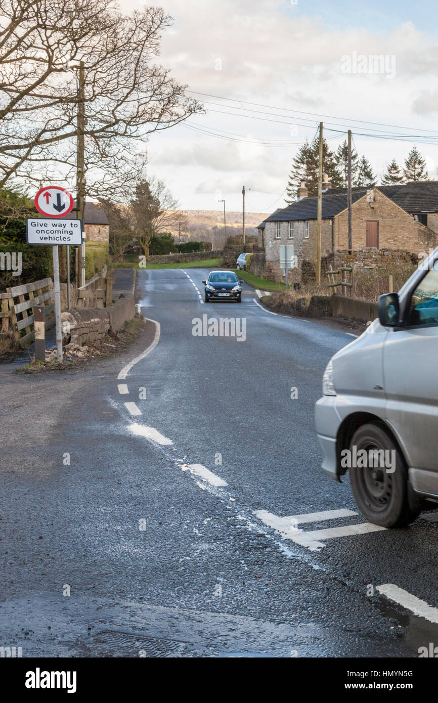 Give way to oncoming vehicles road sign, Brough, Derbyshire, England,UK - Stock Image