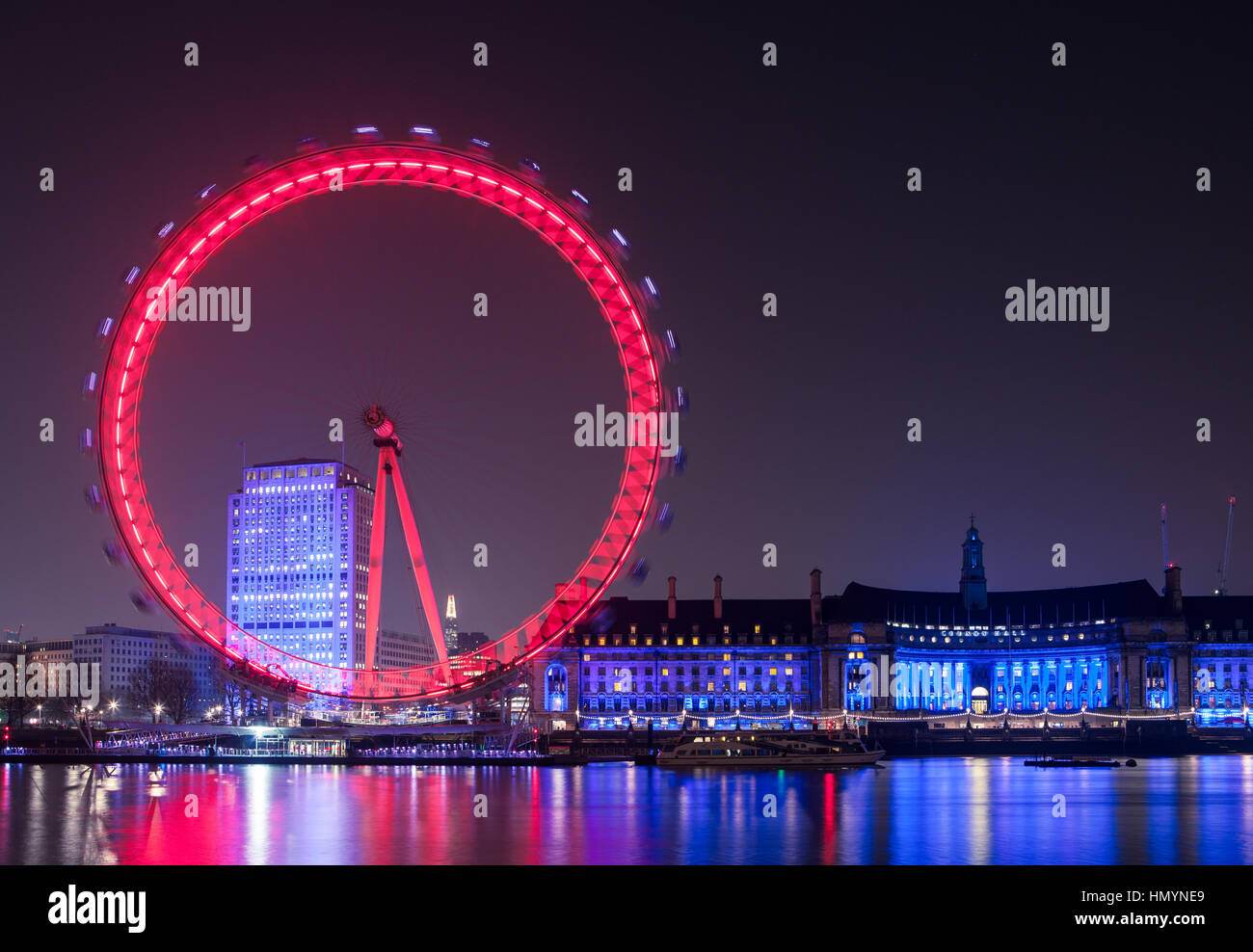 London Eye wheel on River Thames at night - Stock Image