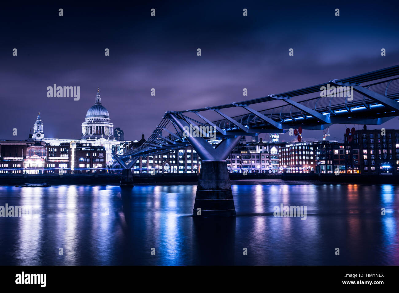 Millennium Bridge in London by night - Stock Image