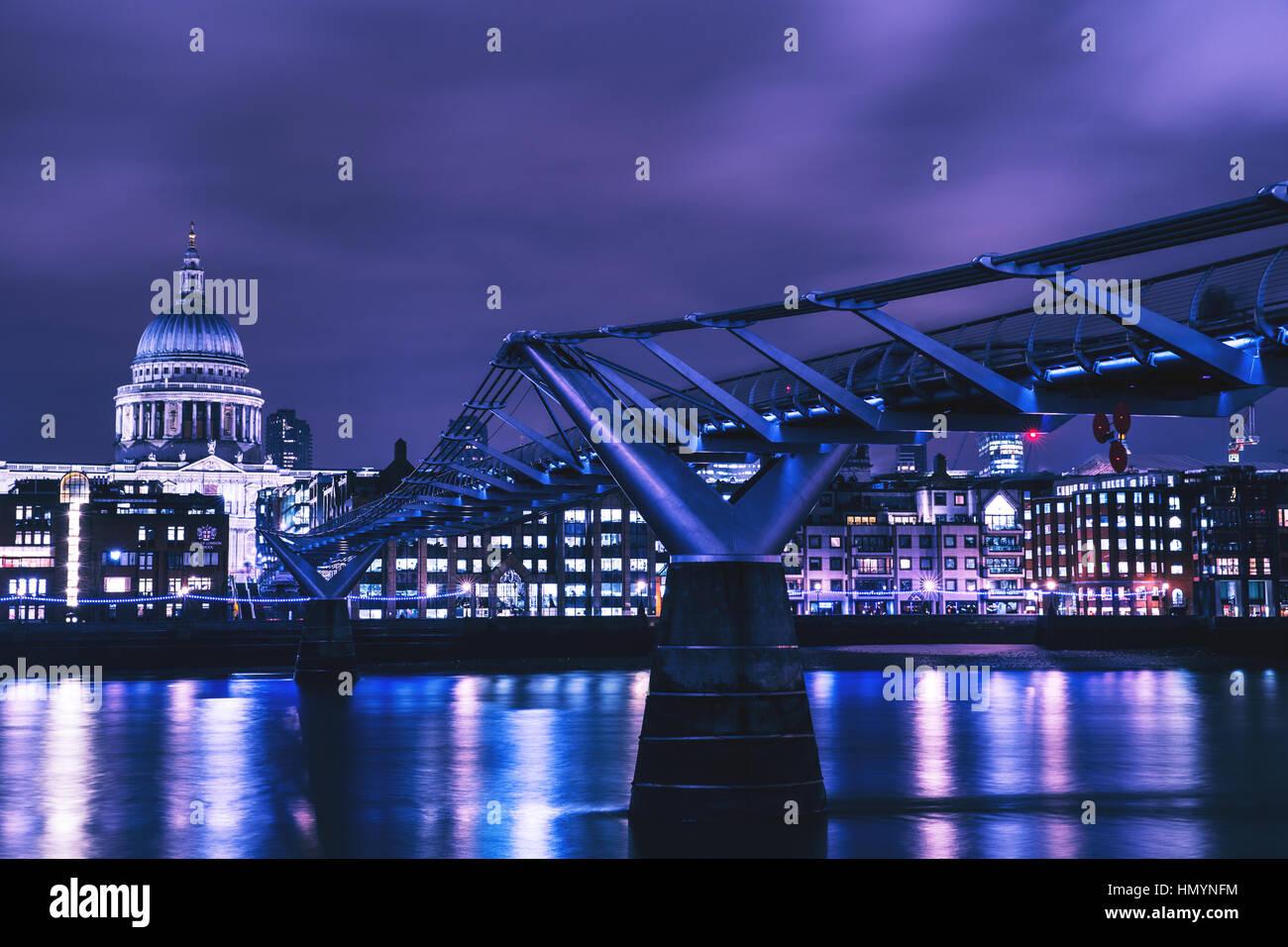 Millennium Bridge on River Thames at night - Stock Image