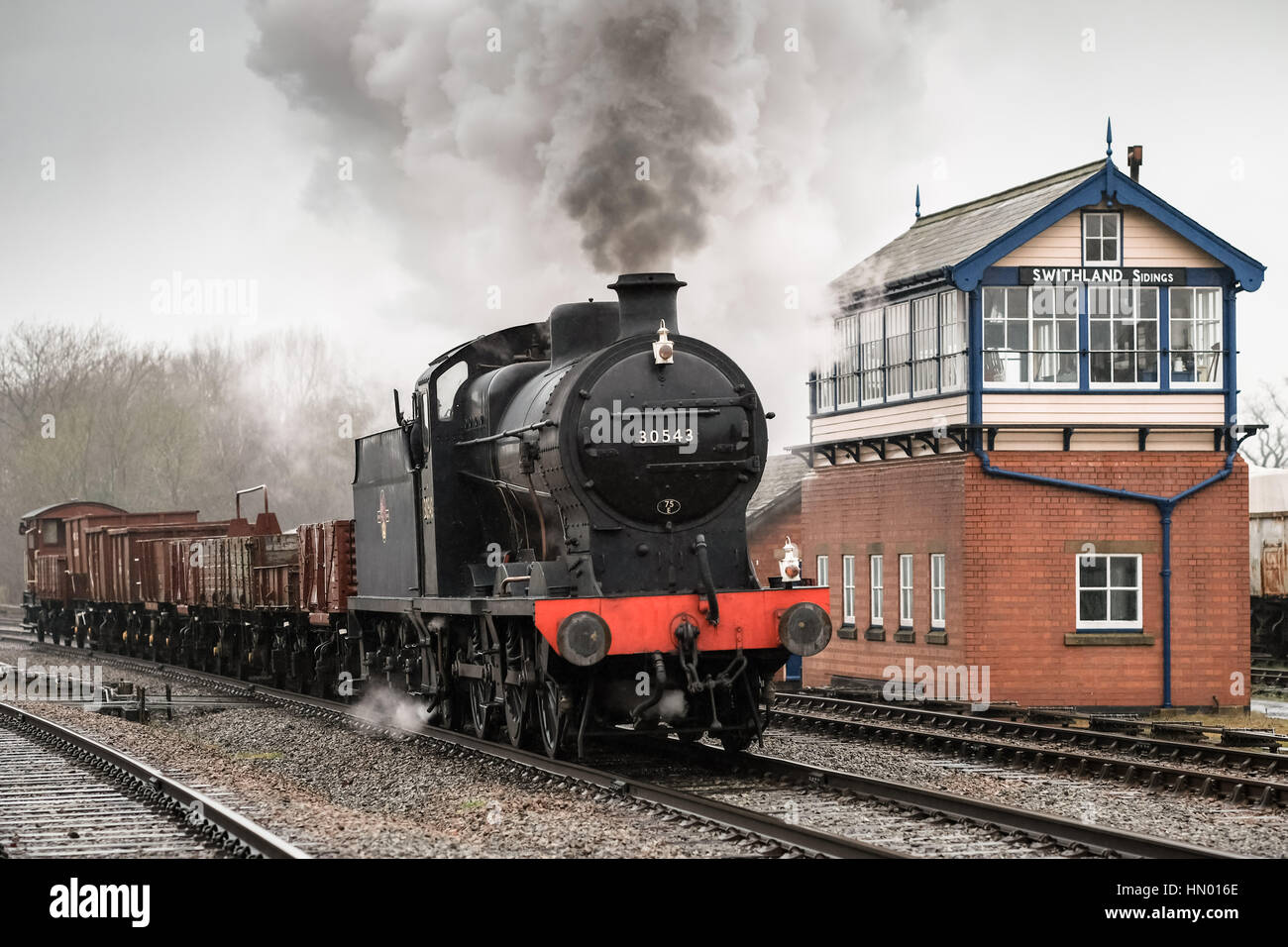Southern Q Class 0-6-0 No. 30543 passes the Signal Box southbound, Swithland Sidings on the Great Central Railway, - Stock Image