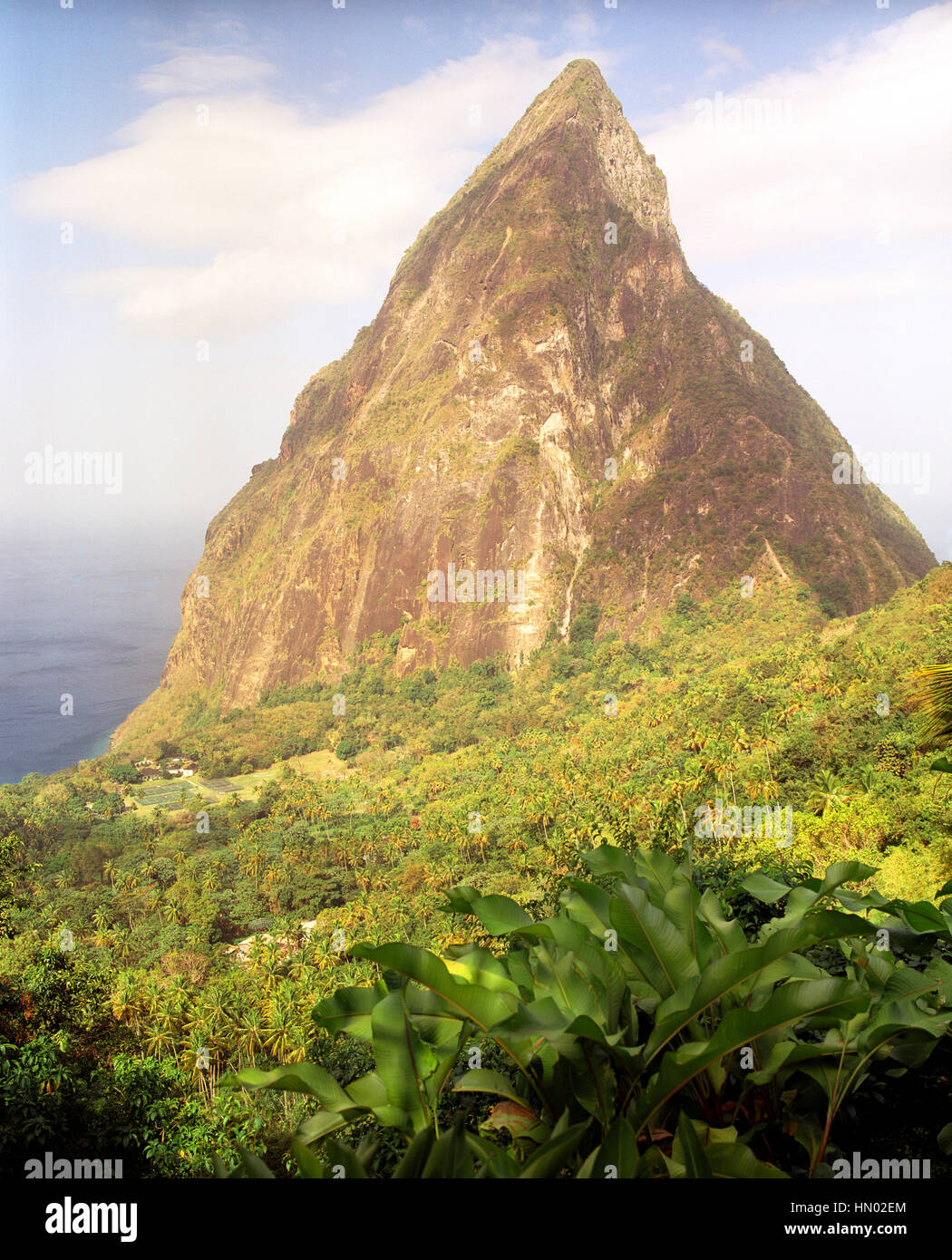 A view of Petit Piton and the Caribbean Sea from Ladera Resort. Ladera is considered on of the best resorts in the - Stock Image