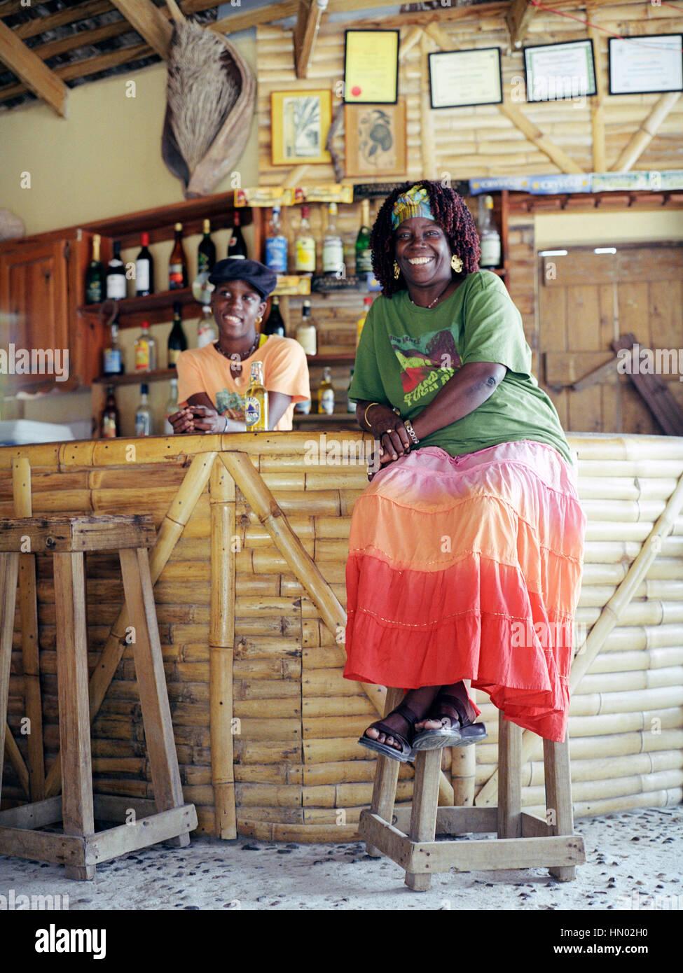 Marjorie Lambert owner of Marjorie's Beach Bar on Cas En Bas beach relaxes at her bar. Cas En Bas, St. Lucia, - Stock Image
