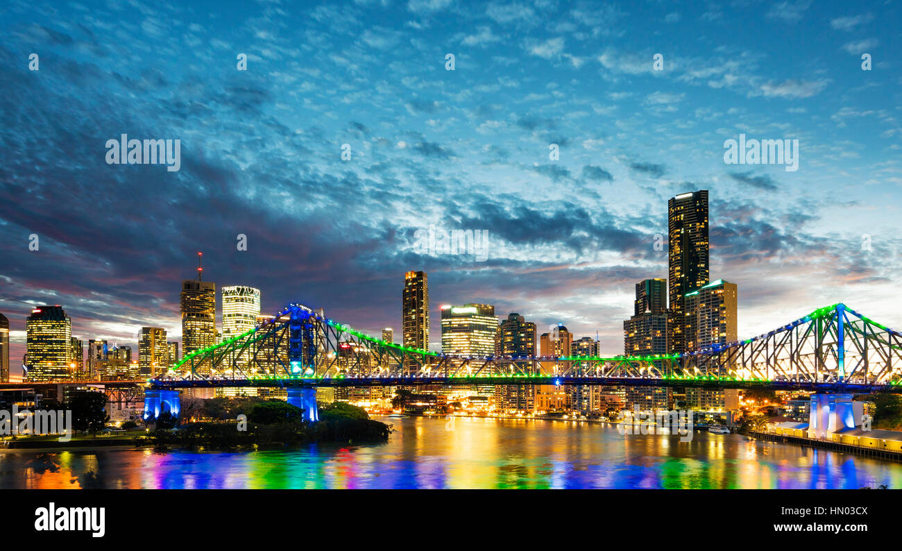 Bridge and skyscrapers in Brisbane at sunset - Stock Image