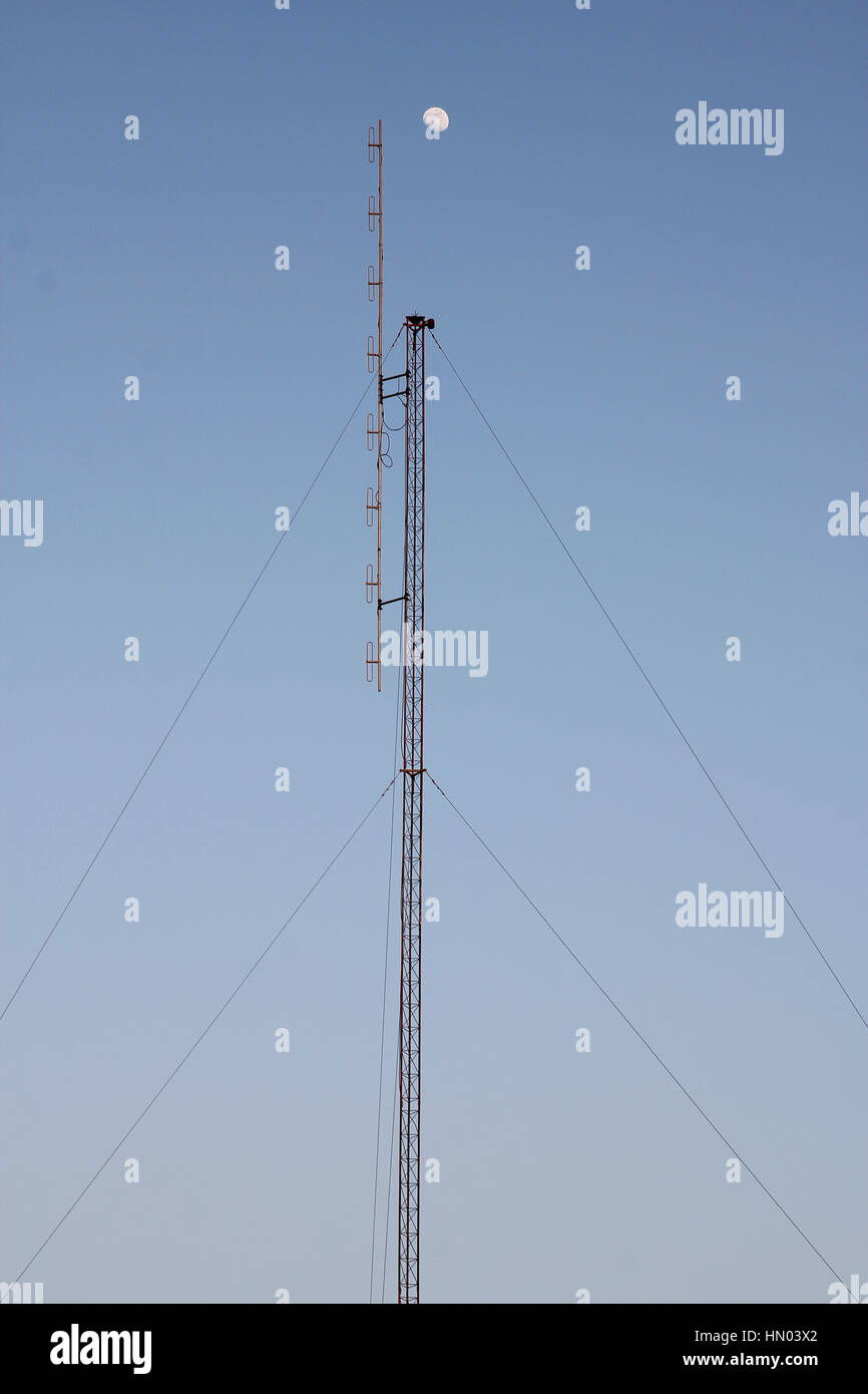 Crescent Moon over cellular antenna in thailand - Stock Image