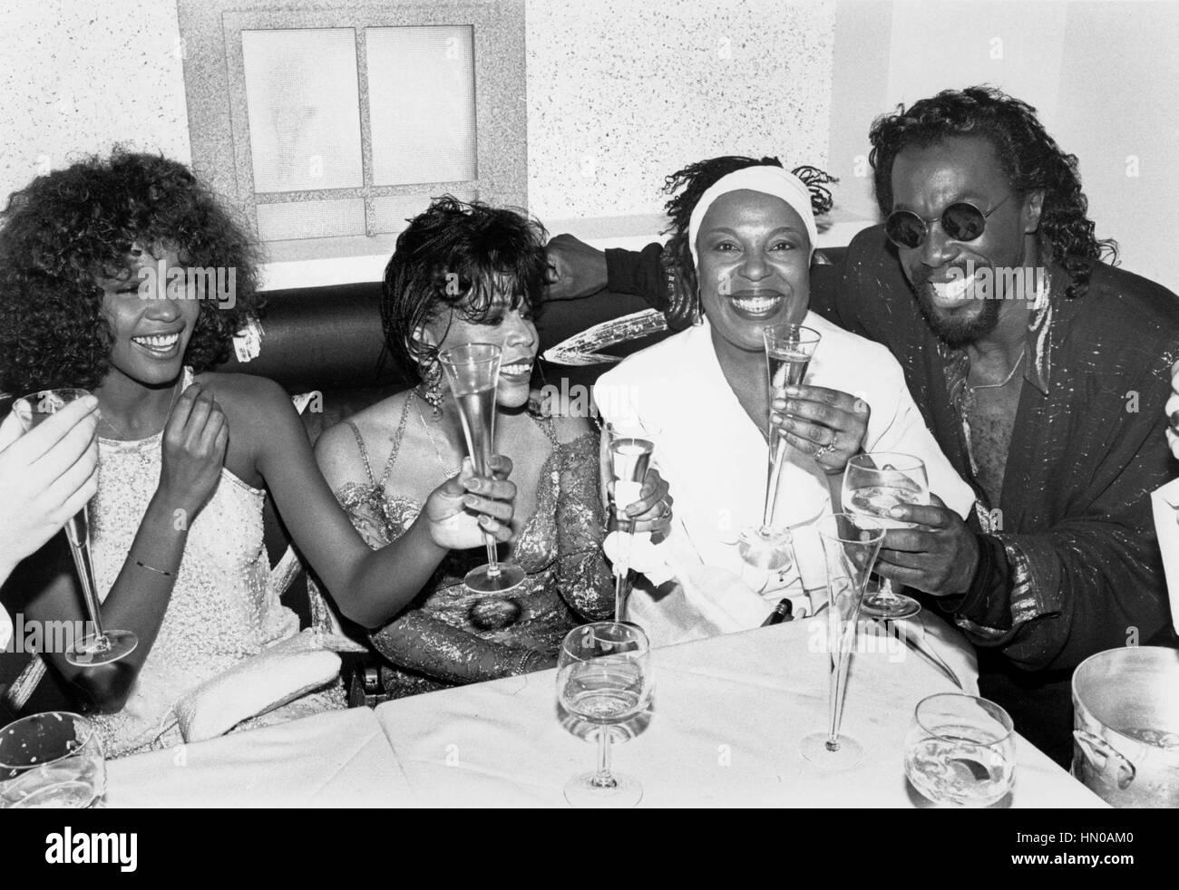 Whitney Houston, Valerie Simpson, Nickolas Ashford, and Roberta Flack toast the opening of Twenty-Twenty, Ashford - Stock Image
