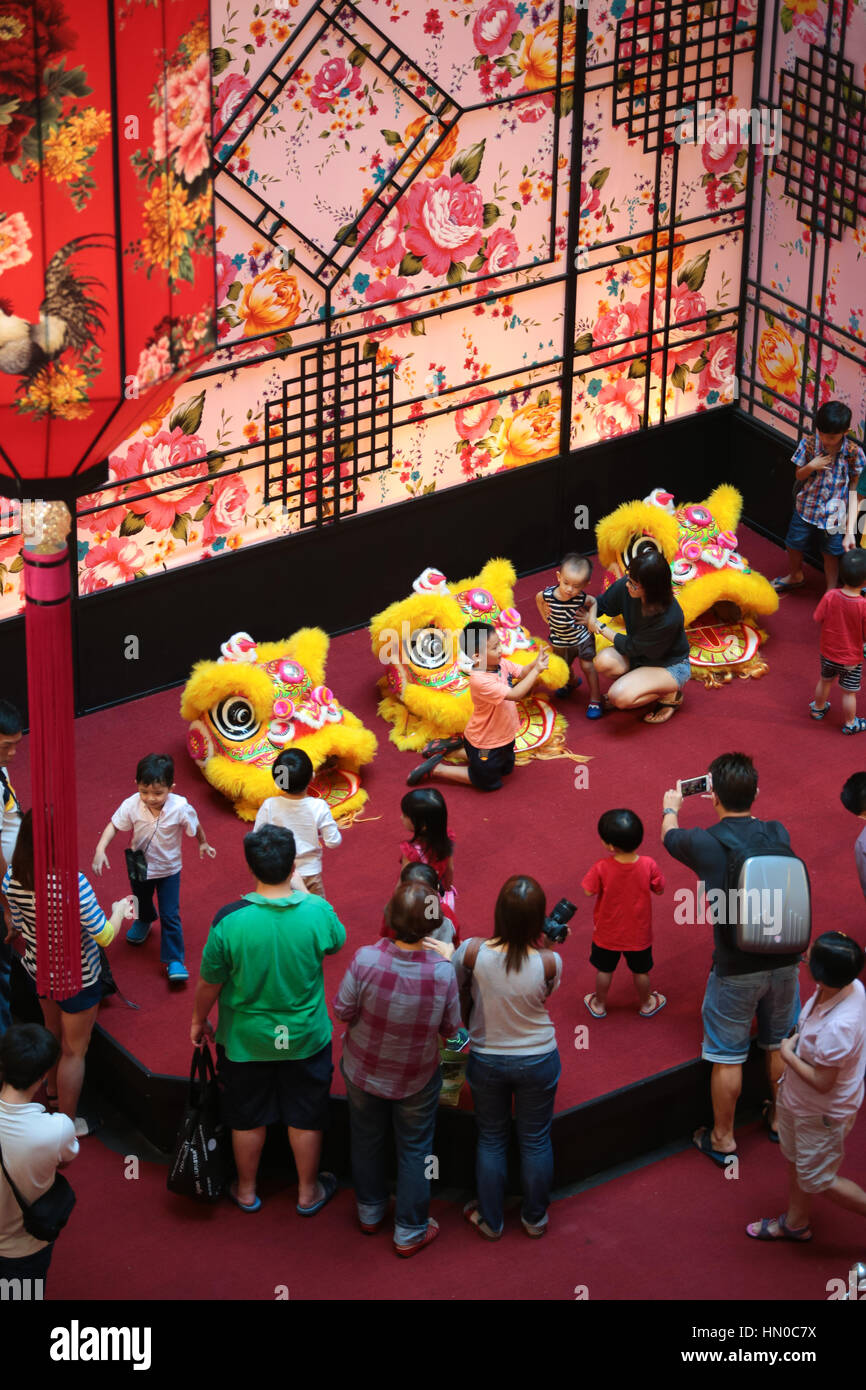 bfacac550 People taking picture of their kids with three lion dance costumes ...