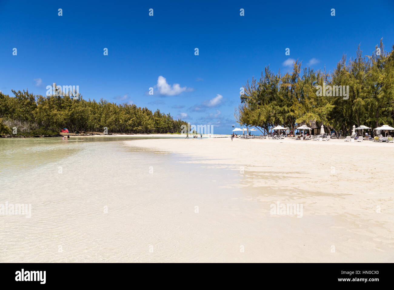 Idyllic beach on ile aux cerfs (deer island) off the coast of Mauritius. This is a popular day trip for tourists - Stock Image