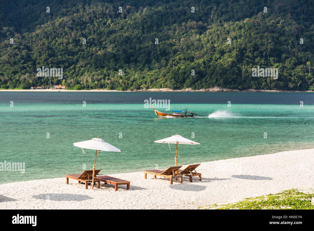 Idyllic white sand beach with long chairs and parasol in Koh Lipe island in south Thailand in the Andaman sea. A - Stock Image