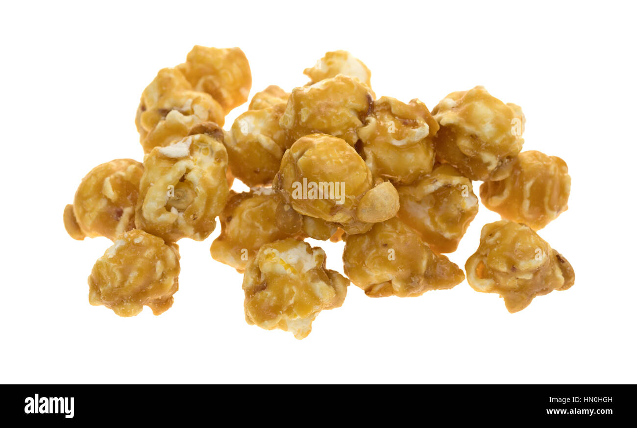 A portion of toffee caramel popcorn with nuts isolated on a white background. - Stock Image