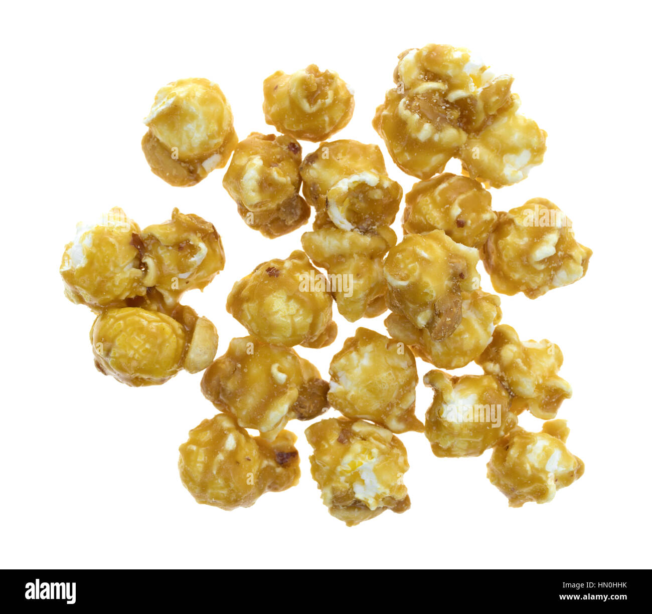 Top view of a portion of toffee caramel popcorn with nuts isolated on a white background. - Stock Image