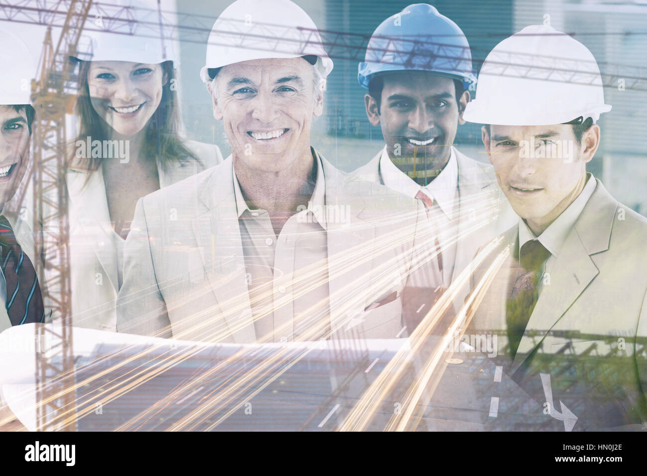 Crane and building construction site  against portrait of architects wearing hardhats - Stock Image