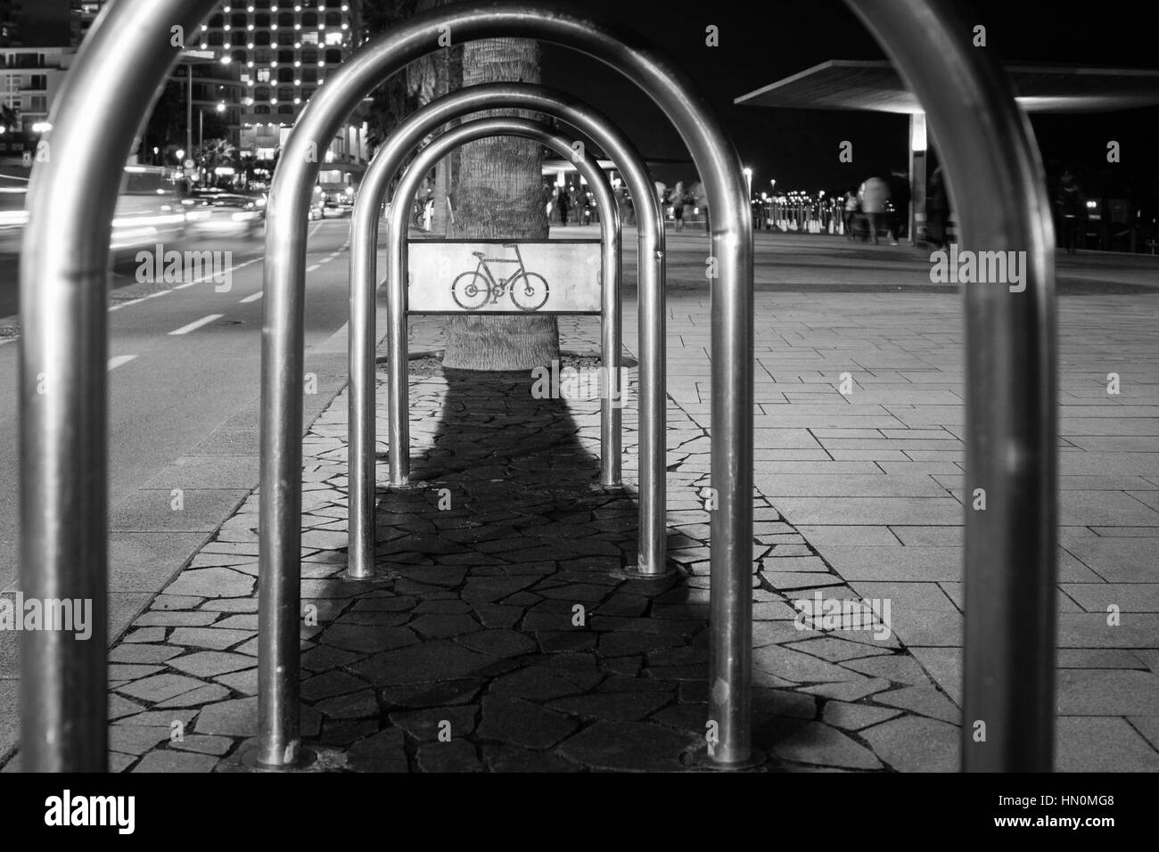 Bike Rack at Night - B&W - Black & White - Bicycle Emblem - Tel Aviv, Israel - Stock Image