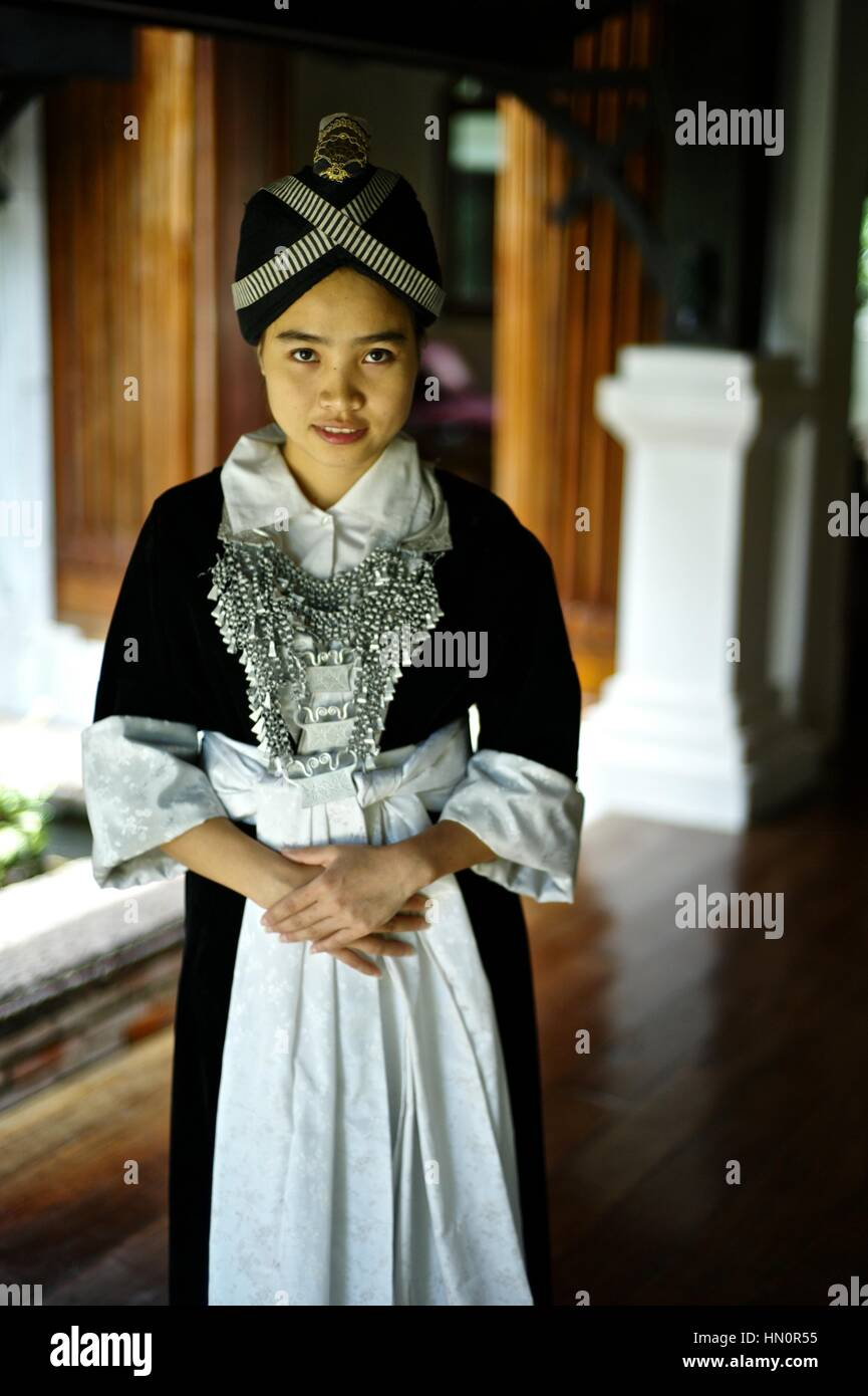 Young girl wearing a Hmong Kao traditional dress in Laos. Name: Anna Saksena Stock Photo